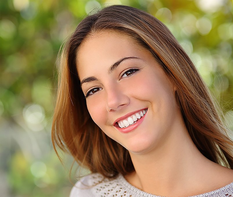 Young woman with great cosmetic dental care