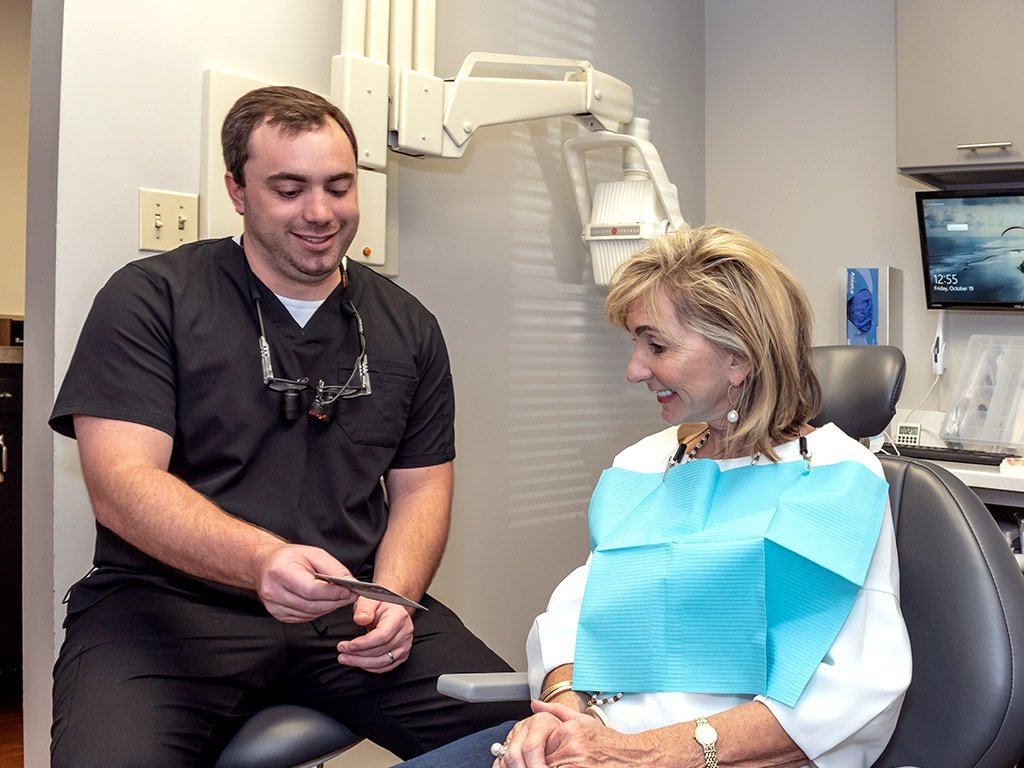 Dr. Hill smiling with senior patient